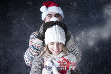 Happy funny  couple   covering  snow background.fooling around.