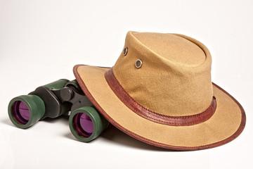 safari hat and binocuars