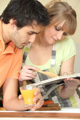 Couple with cook book