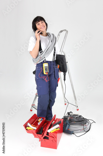 woman electrician with tools