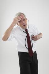 Sick man checking his own heart