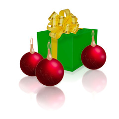 green gift box with gold ribbon and bow and Christmas balls isol