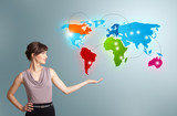 Fototapety Young woman presenting colorful world map