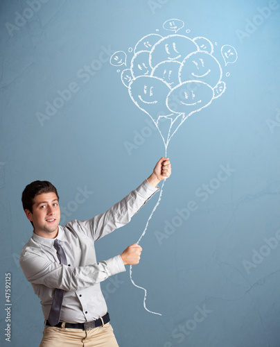 Happy man holding smiling balloons drawing
