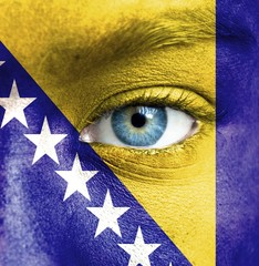 Human face painted with flag of Bosnia and Herzegovina