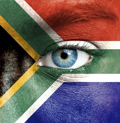 Human face painted with flag of South Africa