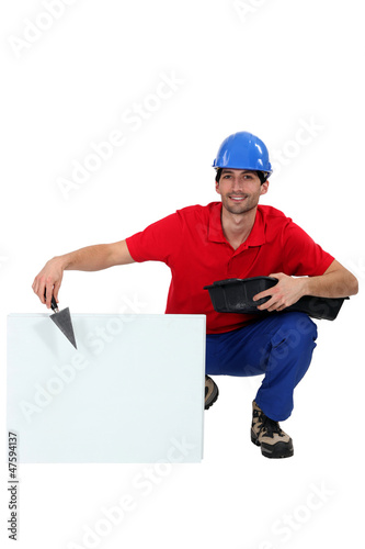 builder with trowel and cement