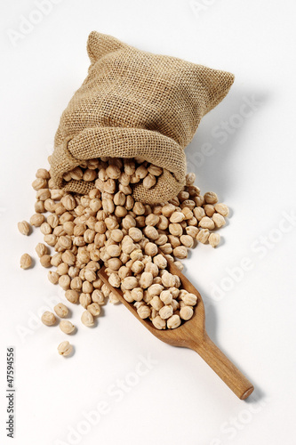 chickpeas in sack with wooden spoon