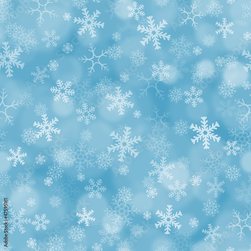 Seamless blue background with snowflakes