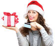 Christmas. Happy Smiling Woman with Gift Box and Credit Card