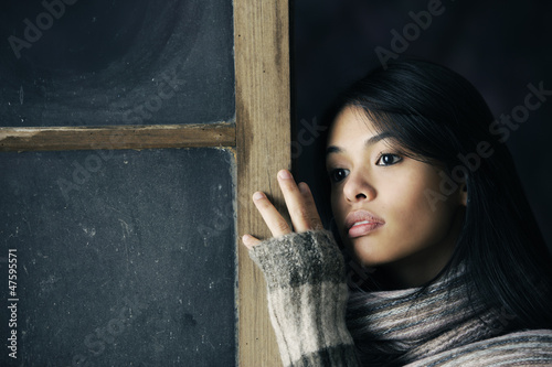 Beautiful girl at window