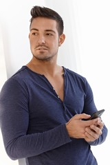 Athletic man with mobile phone