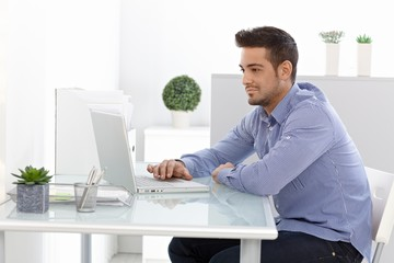 Young man using laptop computer