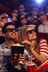 Happy couple in 3D movie