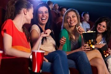 Happy girls in multiplex movie theater