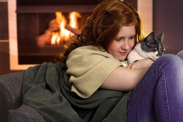 Girl loving cat at home