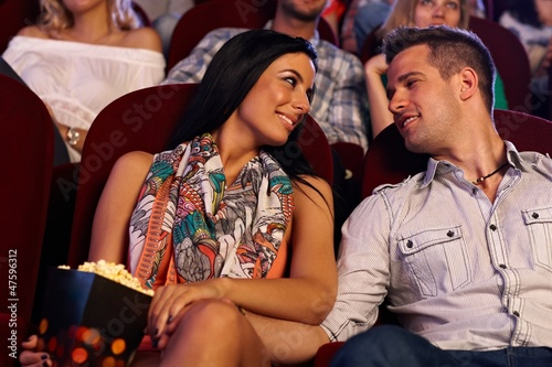 Happy loving couple in cinema
