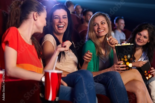 Happy girls in multiplex movie theater