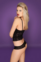 Sexy blonde in lacy black underwear