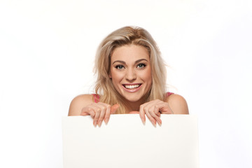 Happy blonde woman with blank sign