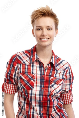 Portrait of young woman in shirt smiling