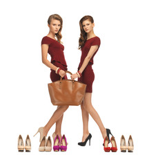 two teenage girls in red dresses with bag