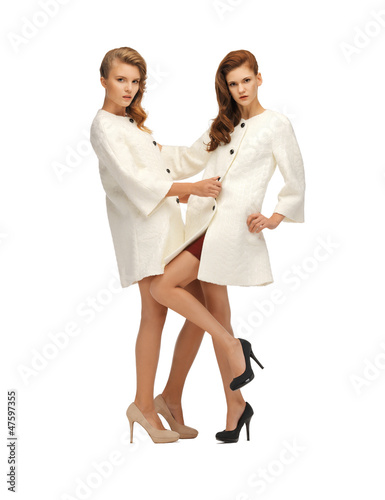 two lovely teenage girls in white coats