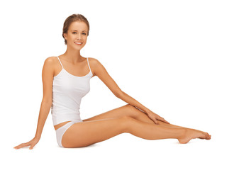 woman in cotton undrewear touching her legs