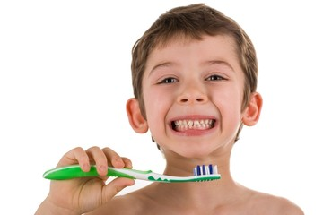 Boy holding a toothbrush