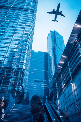modern building with airplane at dusk
