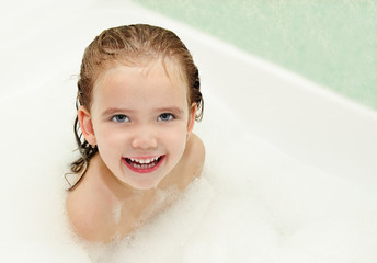 Cute little girl is taking a bath