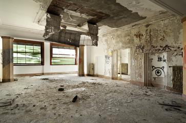 abandoned building, large room, debris on the floor