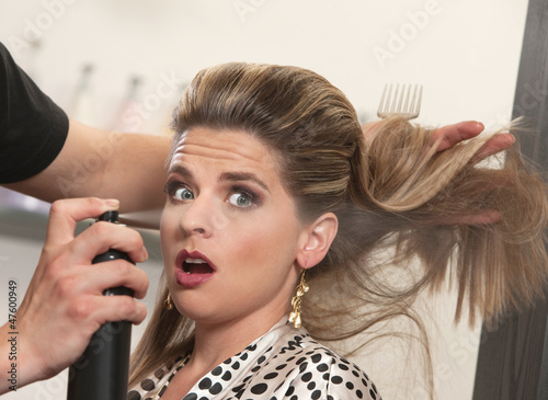 Stylist Uses Hairspray on Surprised Woman