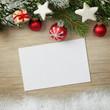 Weihnachtliches mit Schnee auf Holz mit Zettel