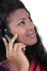 black woman at phone