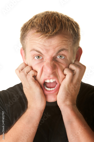Angry Man Clawing His Face
