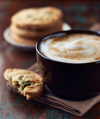 Cup of Latte Coffee with Pistachio Cookies