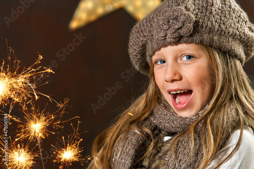 Sweet girl having fun with fireworks.