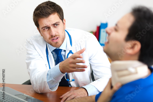 Doctor visiting a patient in his studio