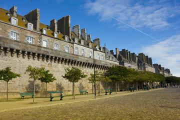 castle walls of Saint Malo old city over sea embankment