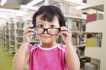Girl wearing glasses in school