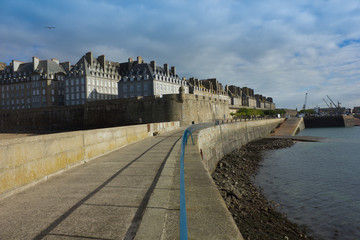 castle walls of Saint Malo old town and port over sea as viewed