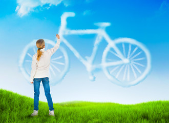 Beautiful nature background with a girl drawing bicycle