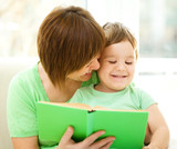 Mother is reading book for her son