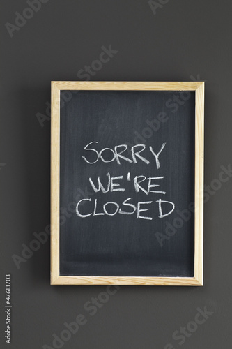 Closed. Store sign on black board