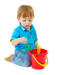 cute little boy with toy bucket, isolated on white