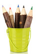 Colorful wooden pencils in green pail isolated on white