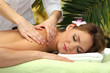 beautiful woman in spa salon  getting massage with stones,