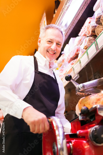 Shopkeeper at work in a grocery store