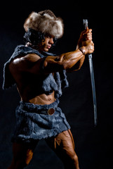 Male warrior with a sword in the form of a barbarian